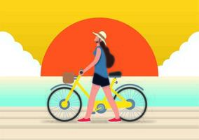 Woman walking bike at sunset