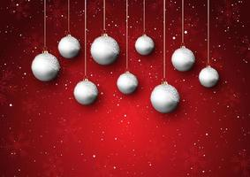 Christmas baubles on a snowy background