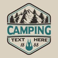 T-shirt design with mountains in vintage style on the camping theme.