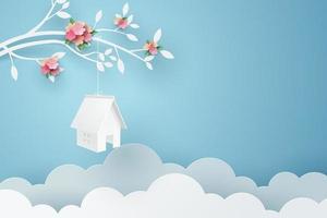 Arte de papel de la casa colgar en la rama de un árbol vector