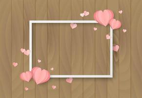 Valentines day wooden background with heart shape and white frame