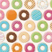 Pattern background with colorful glossy donuts
