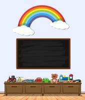 Chalkboard with toys and rainbow