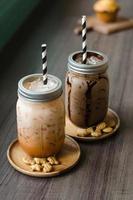 Iced coffee with milk in vintage jar