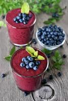 Glasses of blueberry smoothie