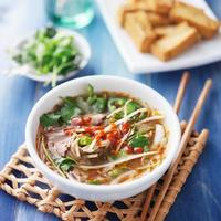 bowl of vietnamese Pho Tai beef soup photo