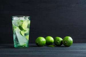 Fresh cocktail with lime slices photo