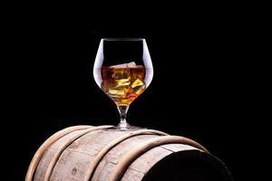 Cognac or brandy on a wooden barrel photo