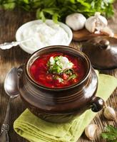 """Traditional red soup """"Borscht"""" with sour cream"""
