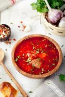 Traditional Ukrainian Russian vegetable soup, borsch with garlic donuts, pampushki