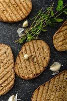 Toasts bread panini with garlic photo