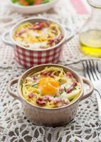 Baked pasta spaghetti carbonara with egg yolk, cheese and bacon