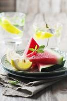 Fresh watermelon and lemon on the wooden table