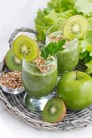 healthy green smoothie with sprouts and ingredients, vertical photo