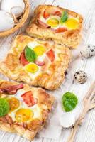 Pie of quail eggs with tomato