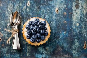 Blueberry tart and teaspoons