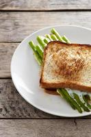 Asparagus with egg and bread c