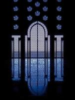 Blue reflections thru windows framing door into mosque