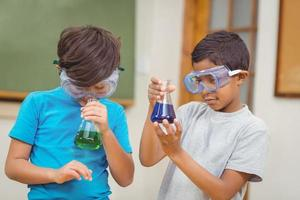 Pupils at science lesson in classroom photo