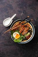 Duck noodles with egg and pak choi cabbage