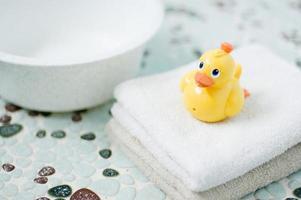 Plastic yellow duck toy in bathroom.