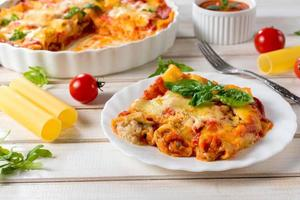 Pasta cannoli with cheese and meat photo