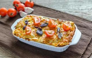 Lasagna with cherry tomatoes photo