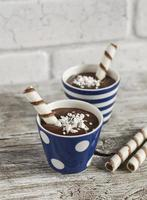 Chocolate pudding with cookies in ceramic vintage glasses