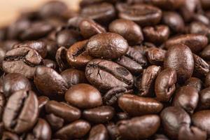 grano de café sobre fondo de madera grunge