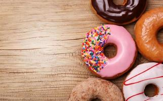 Donuts on wooden background