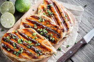 Grilled chicken breasts in lime sauce photo