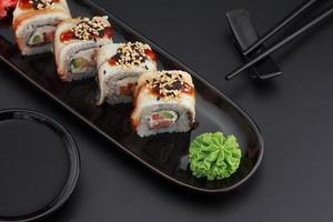 Premium quality sushi rolls over black background