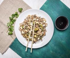 delisious Japanese buckwheat noodles squid and oyster mushrooms  rustic background