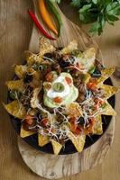 Nacho party platter on wood table photo