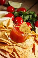 Nachos, tomato sauce, tomatoes, greens, lime
