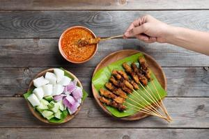 People eating sate photo