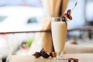 milkshake with fresh plums photo