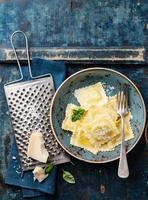 Ravioli pasta with parmesan