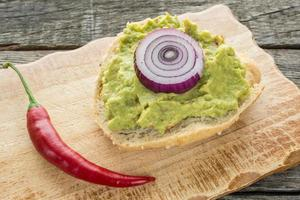 Roll with avocado and red chili pepper photo