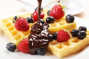 Belgian waffles topped with fruit