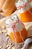 Pumpkin puree with yogurt and seeds closeup