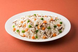 Indian Pulav or vegetables rice or veg biryani  orange background