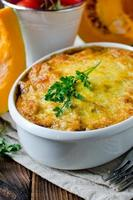 Gratin of pumpkin pasta and minced meat