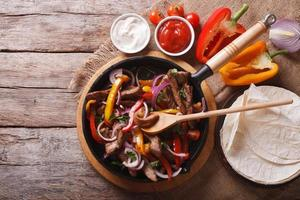 Mexican fajitas on a table. horizontal top view photo