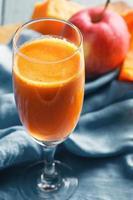 Pumpkin and apple juice closeup