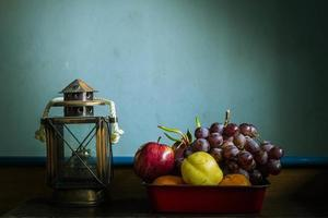 fruits in trays and lamps on the table