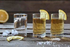 Glasses of tequila with lemon and salt photo