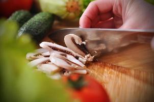 Chef cuts champignon photo
