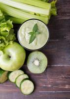 Green smoothie, vegetables and fruits photo
