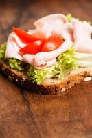 Ham sandwich with tomato close up vertical
